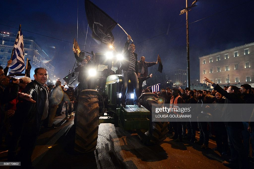 Farmers arrive on their tractors and vehicles in front of the Greek parliament in Athens during a rally against pension reform, on February 12, 2016. Fears that Greece will exit the eurozone, a 'Grexit', could revive if Greek authorities do not come up with 'credible' reforms, notably on pensions, a senior IMF official said February 11. / AFP / LOUISA GOULIAMAKI