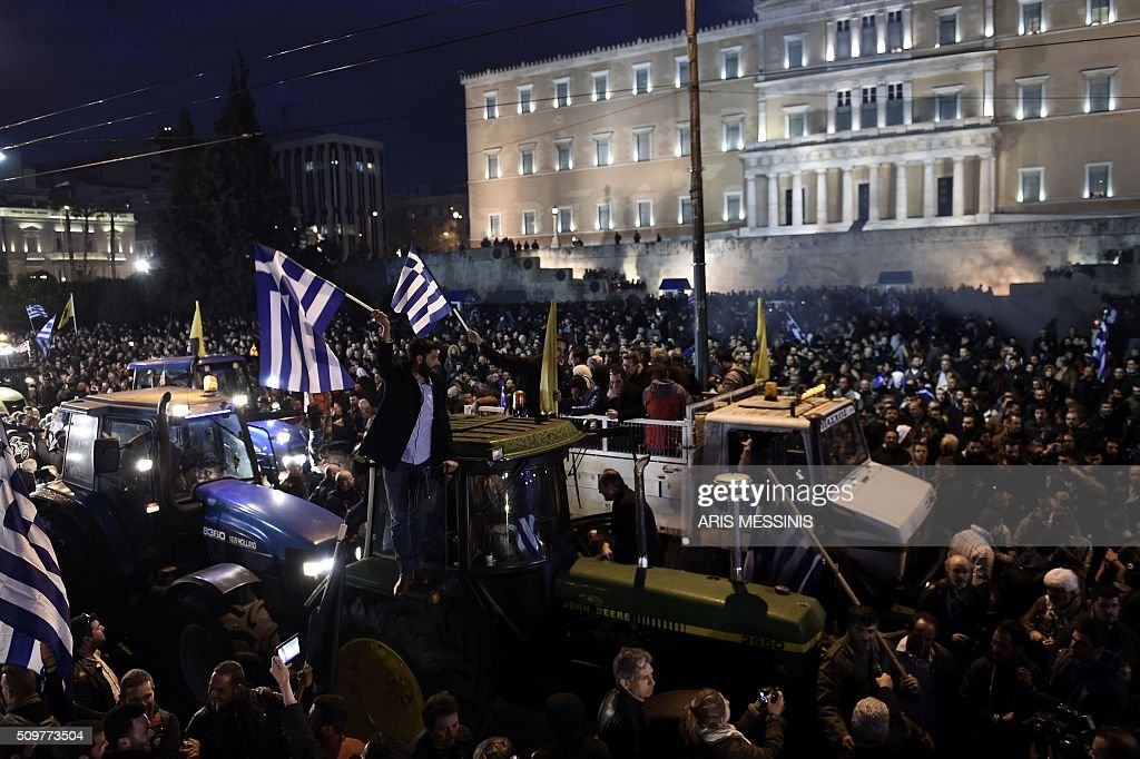 Farmers arrive on their tractors outside the Greek parliament during a protest against pension reform and tax issues, on February 12, 2016. Fears that Greece will exit the eurozone, a 'Grexit', could revive if Greek authorities do not come up with 'credible' reforms, notably on pensions, a senior IMF official said February 11, 2016. / AFP / ARIS MESSINIS