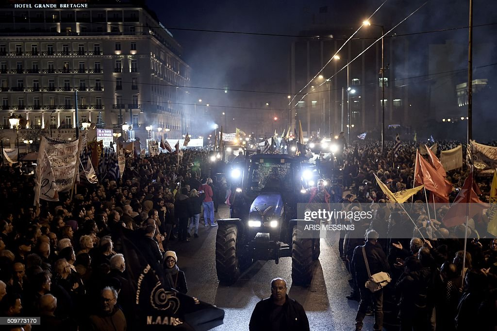 Farmers arrive with tracktors outside the Greek parliament during a protest against pension reform and tax issues, on February 12, 2016. Fears that Greece will exit the eurozone, a 'Grexit', could revive if Greek authorities do not come up with 'credible' reforms, notably on pensions, a senior IMF official said February 11. / AFP / ARIS MESSINIS