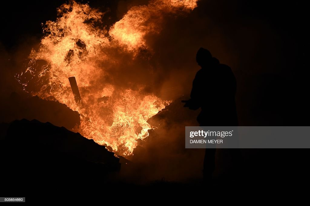 Farmers burn tires on the RN 12 road on January 20 2016 next to Saint Brieuc northwestern France during a demonstration against low prices / AFP /...