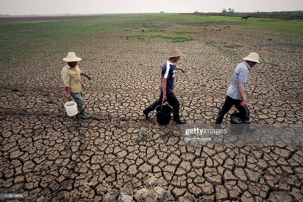 Farmers carry water to water the field on May 9, 2011 in Wuhan, Hubei Province of China. Farmers in most parts of central and southern China are worried about the harvest after seeing one of the driest springs on previous records.