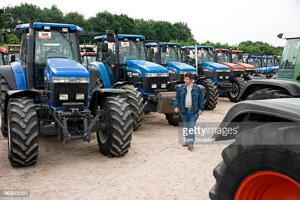 Farmers check out the machinery on offer prior to the sixth international AGRAVIS auction held at Meppen in Emsland Germany 8000 visitors from...