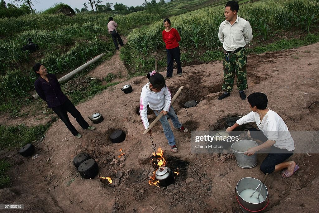 Farmers cook food with gas emitted from a abandoned natural gas well in a village on April 26 2006 in Chongqing Municipality China Local villagers...