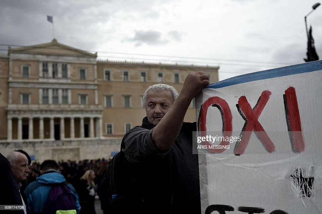 Farmers demonstrate outside the Greek parliament during a protest against pension reform and tax issues on February 12, 2016. Fears that Greece will exit the eurozone, a 'Grexit', could revive if Greek authorities do not come up with 'credible' reforms, notably on pensions, a senior IMF official said February 11. / AFP / ARIS MESSINIS