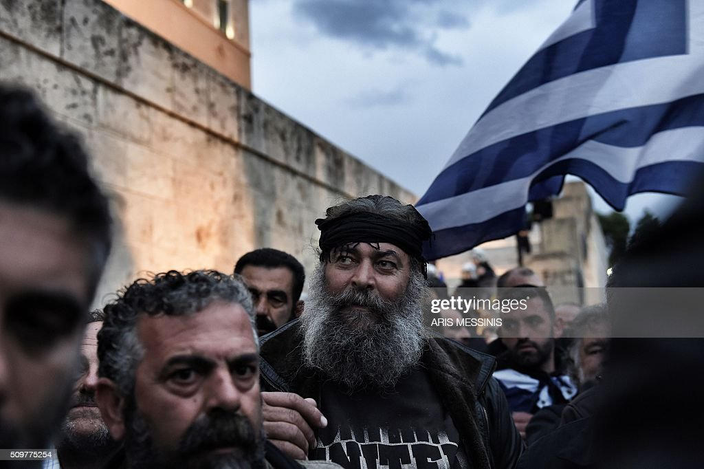 Farmers demonstrate outside the Greek parliament during a protest against pension reform and tax issues, on February 12, 2016. Fears that Greece will exit the eurozone, a 'Grexit', could revive if Greek authorities do not come up with 'credible' reforms, notably on pensions, a senior IMF official said February 11. / AFP / ARIS MESSINIS
