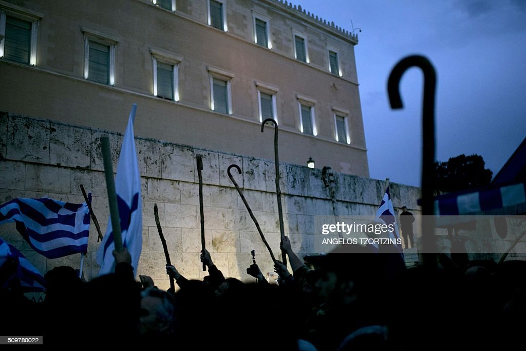 Farmers demonstrate outside the Greek parliament during a protest against pension reform and tax issues, on February 12, 2016. Fears that Greece will exit the eurozone, a 'Grexit', could revive if Greek authorities do not come up with 'credible' reforms, notably on pensions, a senior IMF official said February 11. / AFP / ANGELOS TZORTZINIS