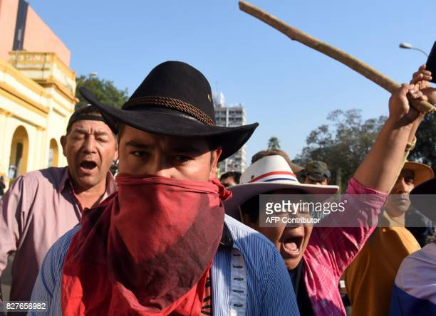 Farmers demonstrate to demand the writing off of their debts in downtown Asuncion on August 8 2017 Farmers are facing economic hardship after failed...