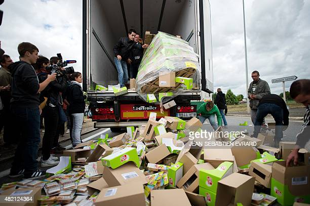 Farmers destroy packages of food transported by a foreign truck as they protest against the low sales prices of their production on July 27 2015 in...