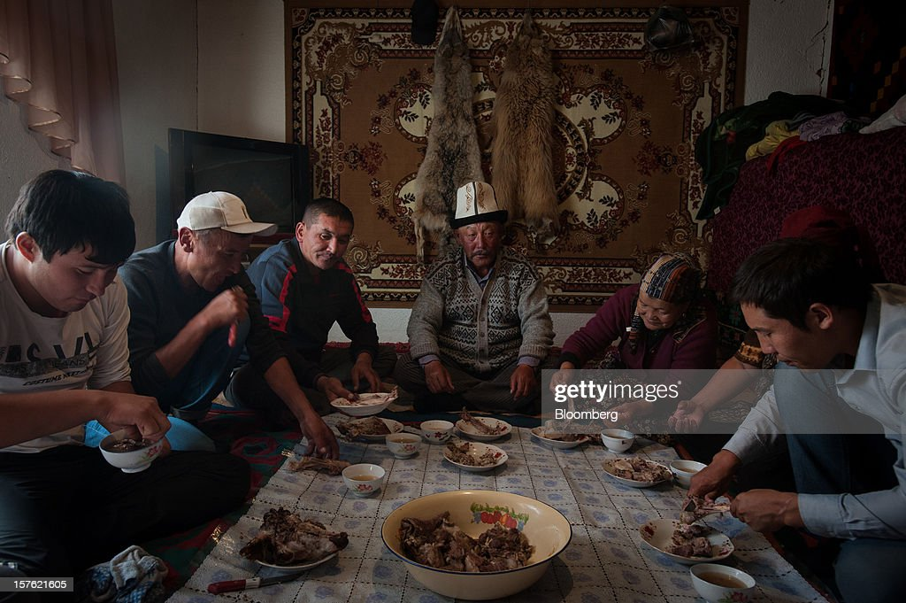 Farmers eat mutton for lunch in Issyk-Kul, Kyrgyzstan, on Tuesday, Sept. 11, 2012. Landlocked Kyrgyzstan is the only country in the world that hosts both Russian and U.S. military bases. Photographer: Noriko Hayashi/Bloomberg via Getty Images