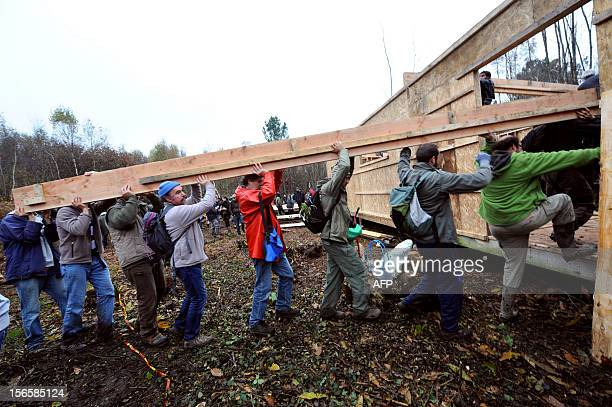 Farmers environmental activists and opponents rebuild the houses that they squatted to protest against a project to build an international airport on...