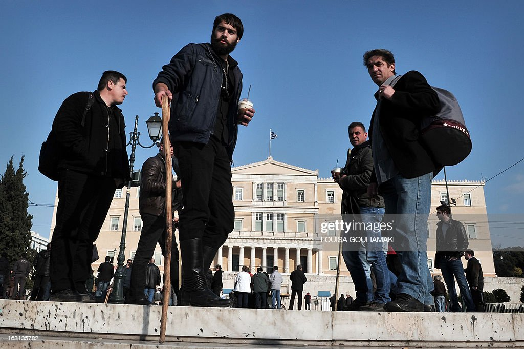 Farmers from Crete island stand in front of the Greek parliament in Athens, during a rally by farmers' unions from all over Greece on March 5, 2013. Some 2,000 Greek farmers gathered in Athens to demand lower taxes, arguing that the rising cost of fuel and electricity was driving them to ruin.The farmers also called for subsidies from the heavily indebted state, which has been forced to undertake a tough austerity policy, to help them lower their costs and remain competitive. AFP PHOTO / LOUISA GOULIAMAKI