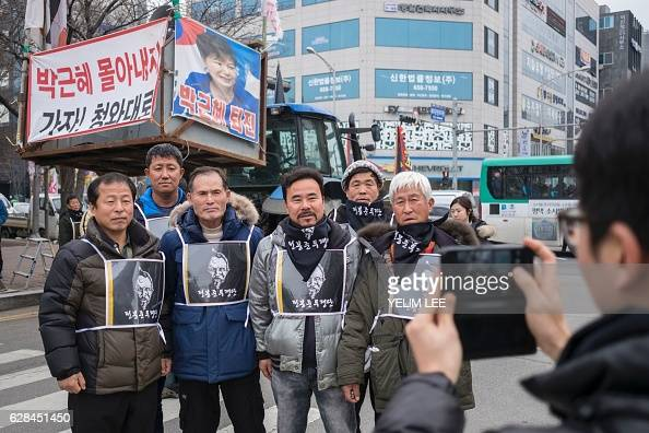 Farmers from Gyeonggi and Chungcheong province wearing the image of historical revolutionary Jun BongJoon pose for a photo in Pyeongtaek on December...