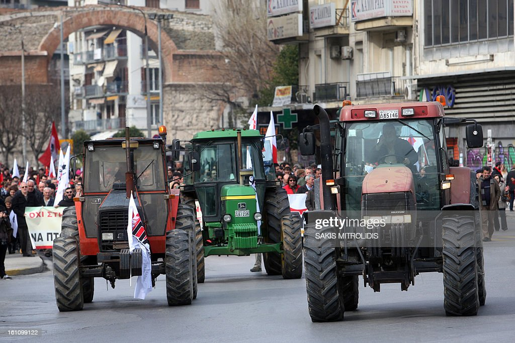 Farmers from PASY, the Greek Communist Party's Farmers trade union coalition, demonstrate with tractors on February 9, 2013 in Thessaloniki to protest against the cost of raw material, such as petrol, they need for their production. AFP PHOTO / Sakis Mitrolidis