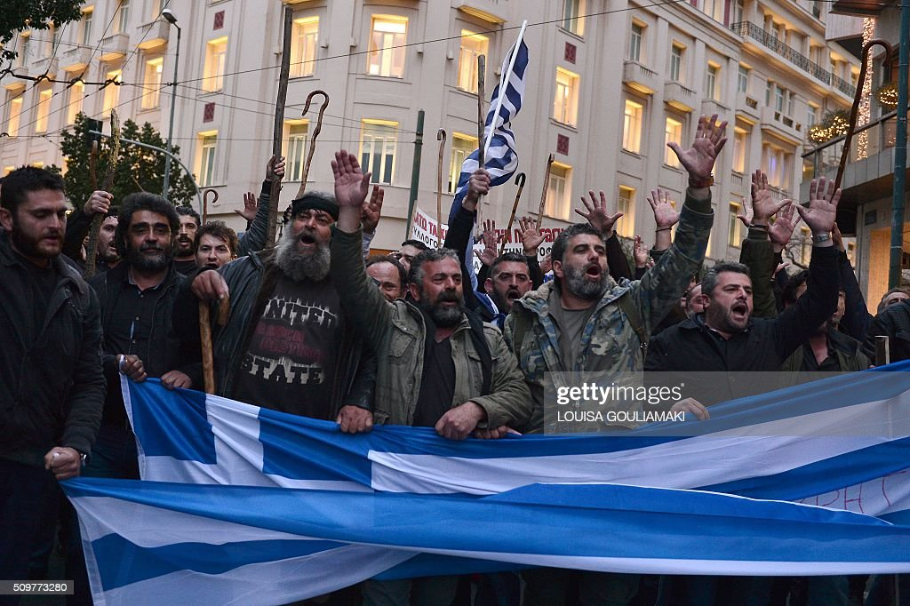 Farmers from the island of Crete march towards the Greek parliament in Athens during their rally against pension reform, on February 12, 2016. Fears that Greece will exit the eurozone, a 'Grexit', could revive if Greek authorities do not come up with 'credible' reforms, notably on pensions, a senior IMF official said February 11. / AFP / LOUISA GOULIAMAKI
