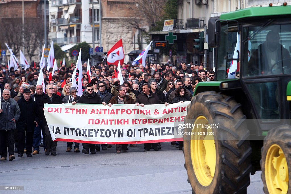 Farmers from the PASY trade union of Farmers coalition of the Greek Communist Party, demonstrate with tractors on February 9, 2013 in Thessaloniki to protest against the cost of raw material, such as petrol, they need for their production. AFP PHOTO / Sakis Mitrolidis