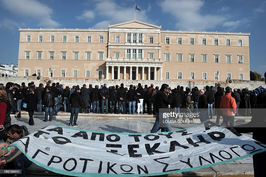 Farmers gather in front of the Greek parliament in Athens during a rally by farmers' unions from all over Greece on March 5, 2013. Some 2,000 Greek farmers gathered in Athens to demand lower taxes, arguing that the rising cost of fuel and electricity was driving them to ruin.The farmers also called for subsidies from the heavily indebted state, which has been forced to undertake a tough austerity policy, to help them lower their costs and remain competitive.