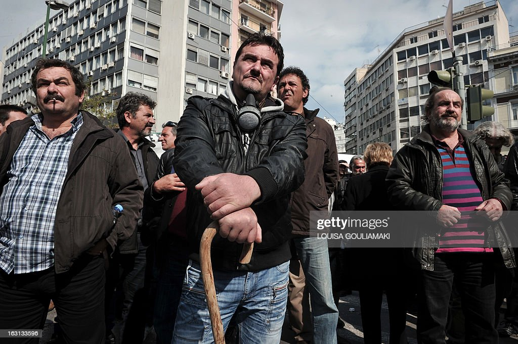 Farmers gather near the agriculture ministry in Athens, during a protest by farmers' unions from all over Greece on March 5, 2013. Over 2,000 Greek farmers gathered in Athens to demand lower taxes, arguing that the rising cost of fuel and electricity was driving them to ruin.The farmers also called for subsidies from the heavily indebted state, which has been forced to undertake a tough austerity policy, to help them lower their costs and remain competitive. AFP PHOTO / LOUISA GOULIAMAKI
