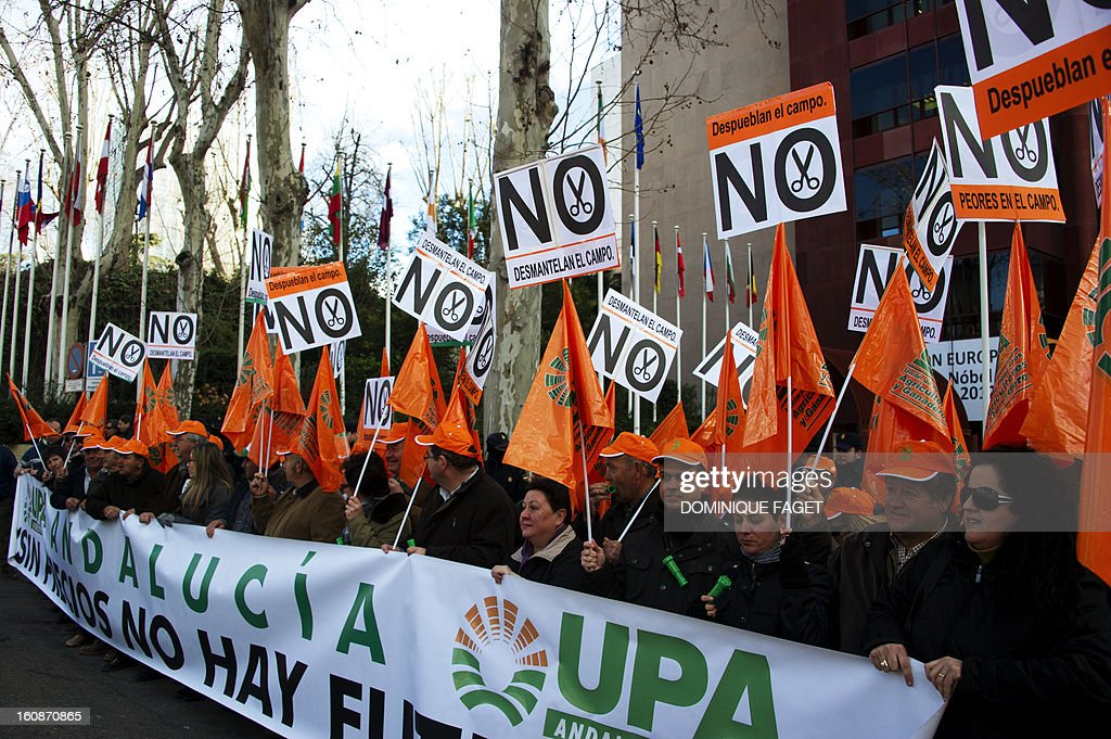 Farmers holds banners and placards during a demonstration called by UPA (Union of Small Farmers and Stockbreeders) to protest against cuts in the agricultural sector, in front of the European Union headquarters in the center of Madrid on February 7, 2013. Hundreds of farmers protested against planned cuts in the EU Common Agricultural Policy (CAP) budget.