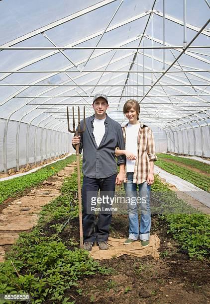 Farmers in an Organic Farm's Greenhouse