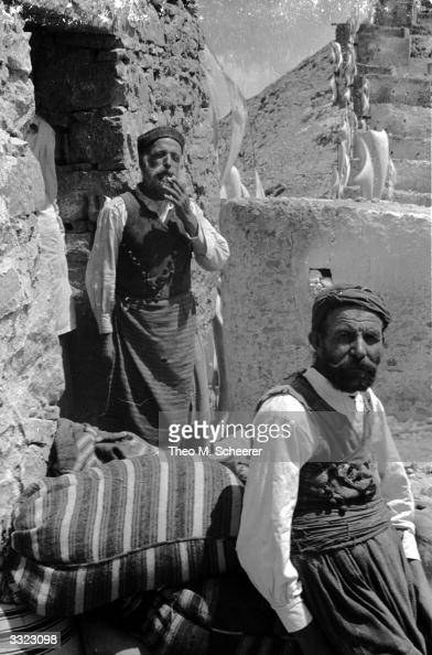Farmers in the valley of Lassithi on the island of Crete The wealth of each farmer is gauged by the number of whitesailled windmills he owns The...