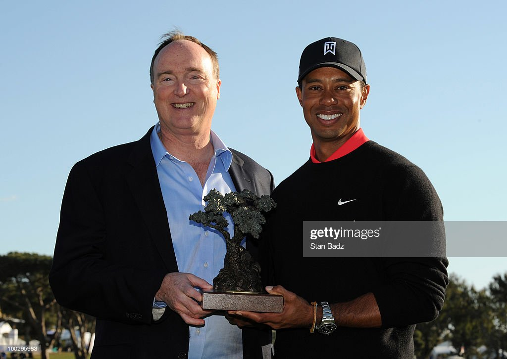 Farmers Insurance CEO Jeff Dailey and Tiger Woods pose with the winner's trophy on the 18th green during the final round of the Farmers Insurance Open at Torrey Pines Golf Course on January 28, 2013 in La Jolla, California.