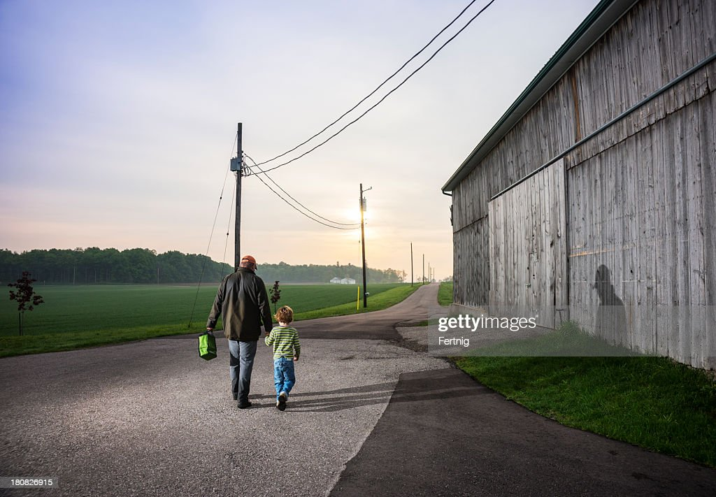 Farmers off to work : Stock Photo