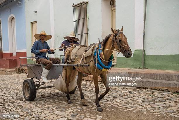 farmers on a horse carriage in Trinidad de Cuba