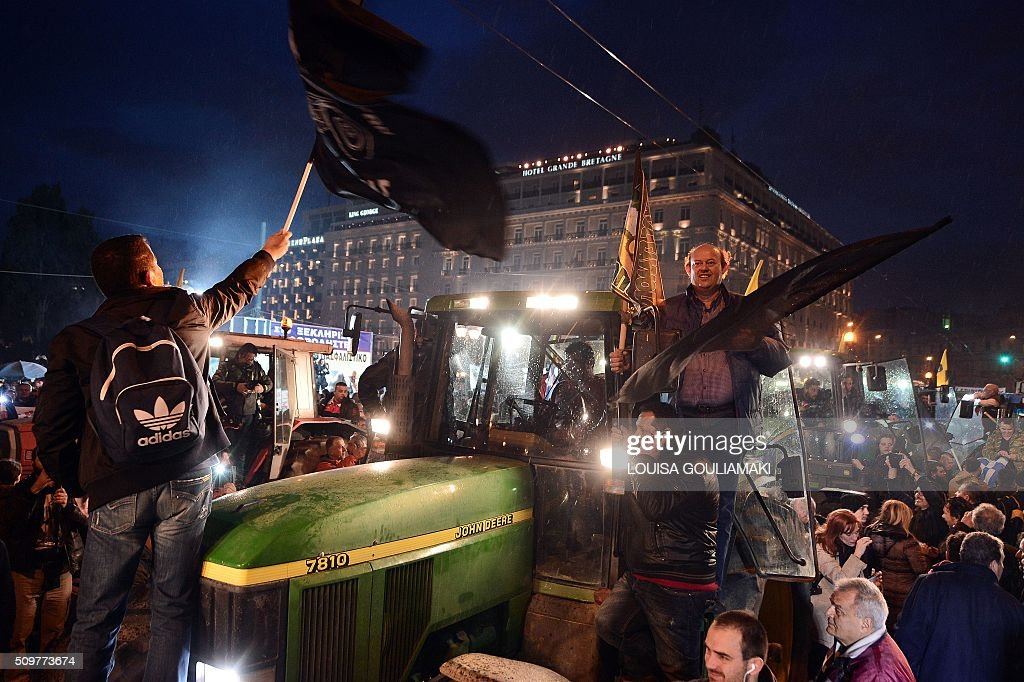 Farmers on their tractors and vehicles arrive in front of the Greek parliament in Athens during a rally against pension reform, on February 12, 2016. Fears that Greece will exit the eurozone, a 'Grexit', could revive if Greek authorities do not come up with 'credible' reforms, notably on pensions, a senior IMF official said February 11. / AFP / LOUISA GOULIAMAKI