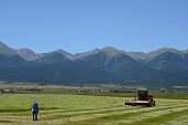 Farmers plow hay on their ranch on July 13 2016 Custer County ranked fifth for its income gap out of 3064 US counties examined by the Keystone...