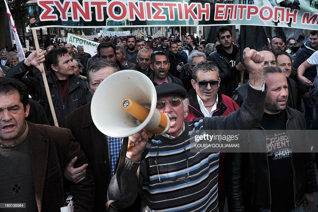 Farmers protest in central Athens, during a rally by farmers' unions from all over Greece on March 5, 2013. Some 2,000 Greek farmers gathered in Athens to demand lower taxes, arguing that the rising cost of fuel and electricity was driving them to ruin.The farmers also called for subsidies from the heavily indebted state, which has been forced to undertake a tough austerity policy, to help them lower their costs and remain competitive. AFP PHOTO / LOUISA GOULIAMAKI