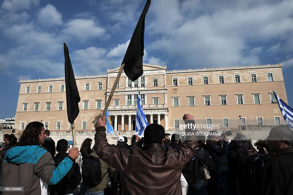 Farmers protest in front of the Greek parliament in Athens, during a rally by farmers' unions from all over Greece on March 5, 2013. Over 2,000 Greek farmers gathered in Athens to demand lower taxes, arguing that the rising cost of fuel and electricity was driving them to ruin.The farmers also called for subsidies from the heavily indebted state, which has been forced to undertake a tough austerity policy, to help them lower their costs and remain competitive.