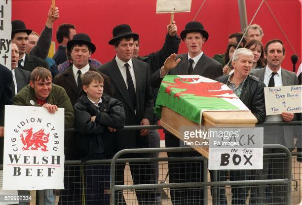 Farmers protesting outside the studios of London Weekend Television use a coffin with the slogan 'Jack in the Box'to get their message across to...