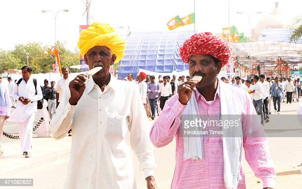 Farmers relish ice creams after the 'Karyakarta Maha Sammelan' of BJP President Amit Shah to boost their morale and push them to work harder and...