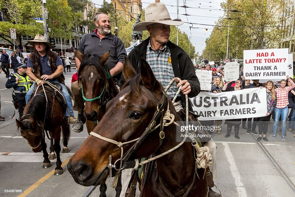 Farmers ride their horse at the city street during a protest demanding Australian government to solve the dairy crisis in Melbourne, Australia on May 25, 2016.