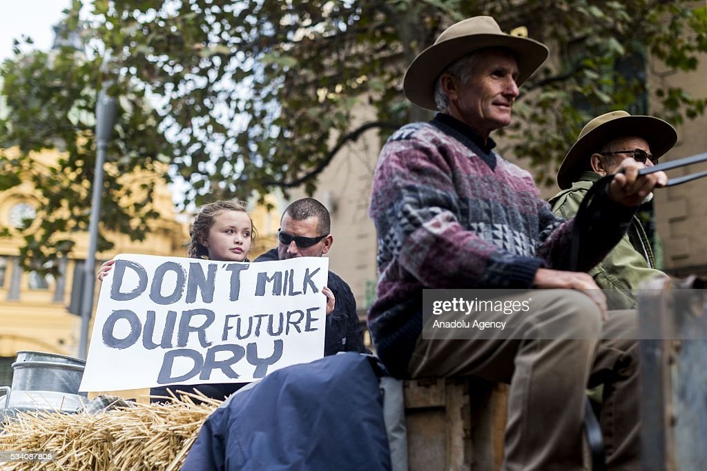 Farmers ride their horses at the city street during a protest demanding Australian government to solve the dairy crisis in Melbourne, Australia on May 25, 2016.