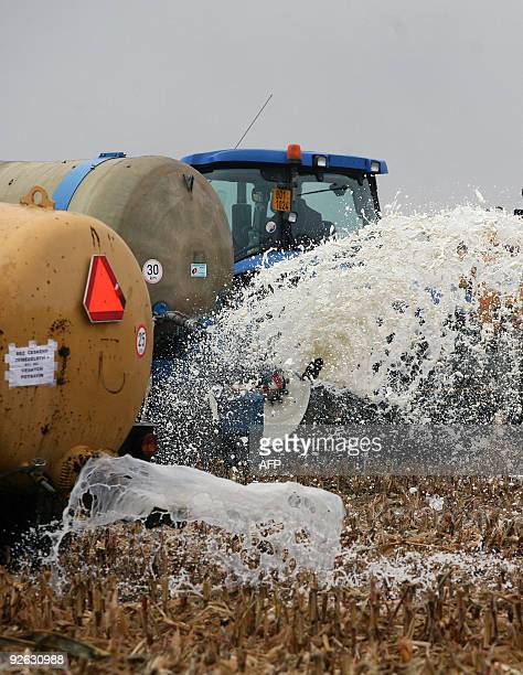 Farmers spray about 50000 litres of milk on a field near Cucice by Oslavany in south Moravia on October 29 2009 during a protest against low prices...