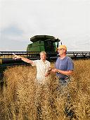 Farmers Standing in Field