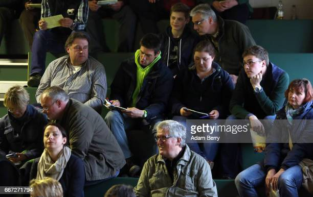 Farmers take notes during an annual heifer auction on April 11 2017 in Gross Kreutz Germany Around 80 Angus Charolais Hereford Uckermärker Blonde...