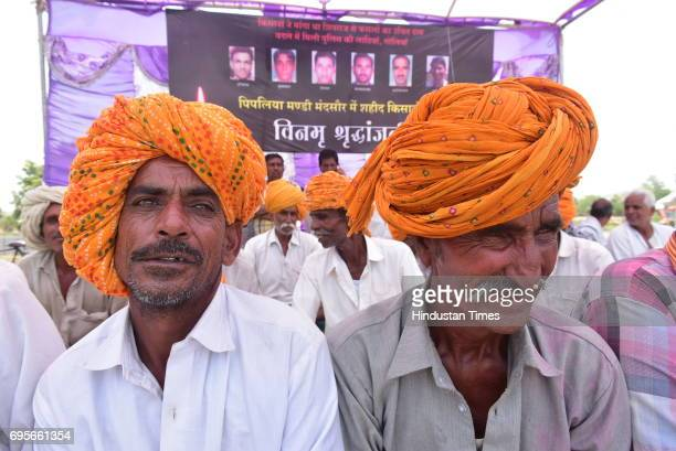 Farmers take part in a condolence meet organized for the victims of Mandsaur police firing at a village Unhel on June 13 2017 in Ujjain India...