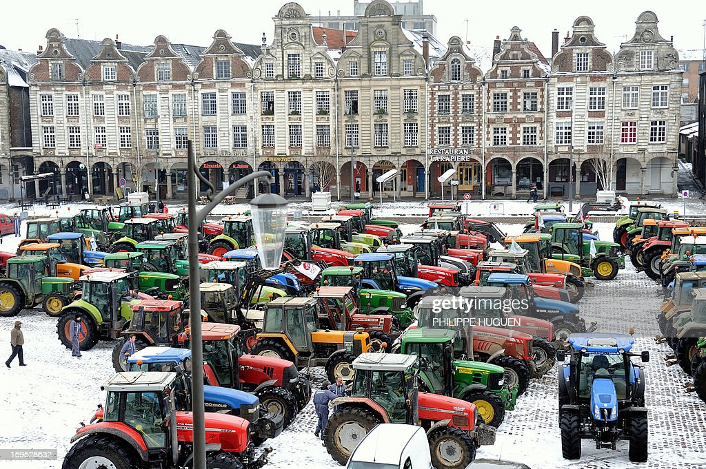 Farmers take part in a partial blockade with some hundred tractors, on January 15, 2013 at the Grand'place in Arras, in northern France, during a demonstration called by farmers local union FDSEA, to denounce all kinds of pressure affecting their activities. AFP PHOTO PHILIPPE HUGUEN