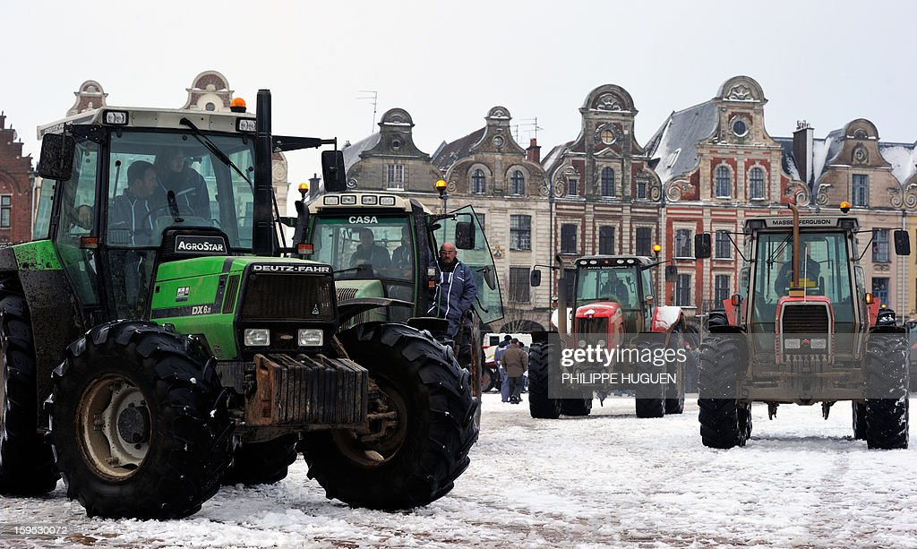 Farmers take part in a partial blockade with some hundred tractors, on January 15, 2013 at the Grand'place in Arras, in northern France, during a demonstration called by farmers local union FDSEA, to denounce all kinds of pressure affecting their activities.