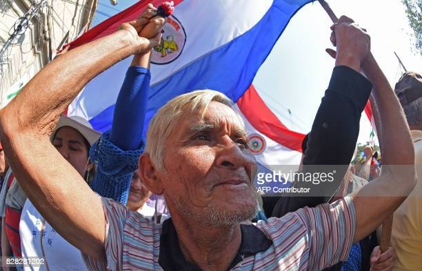Farmers take part in a protest in downtown Asuncion demanding the writing off of their debts on August 9 2017 Farmers are facing economic hardship...