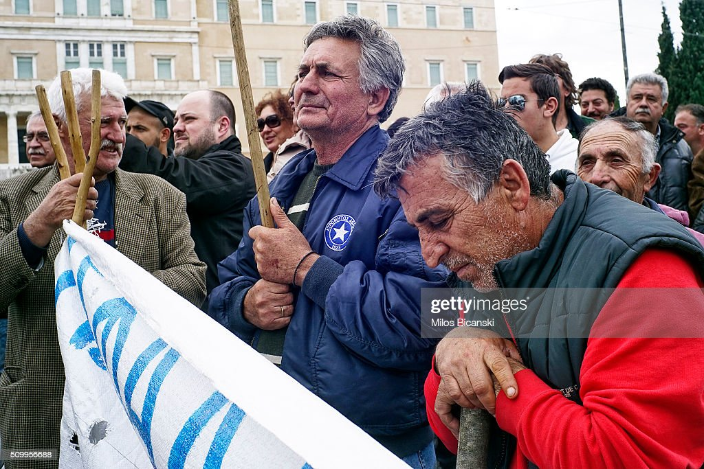 Farmers take part in an anti-government rally in front of the parliament on February 13, 2016 in Athens, Greece. Thousands of farmers from across Greece gather in Athens for a two-day protest against the government and its plans to impose new tax hikes and pension charges.