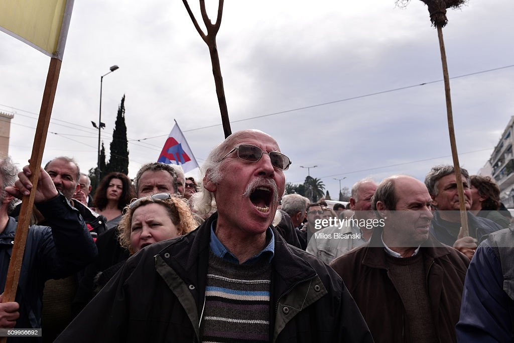 Farmers take part in an anti-government rally in front of the parliament on February 13, 2016 in Athens, Greece. Thousands of farmers from across Greece gather in Athens for a two-day protest against the government and its plans to impose new tax hikes and pension charges. .