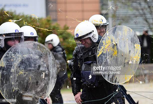 Farmers throw eggs on police forces during a demonstration in front of the European Commission building on September 7 in Brussels as European...