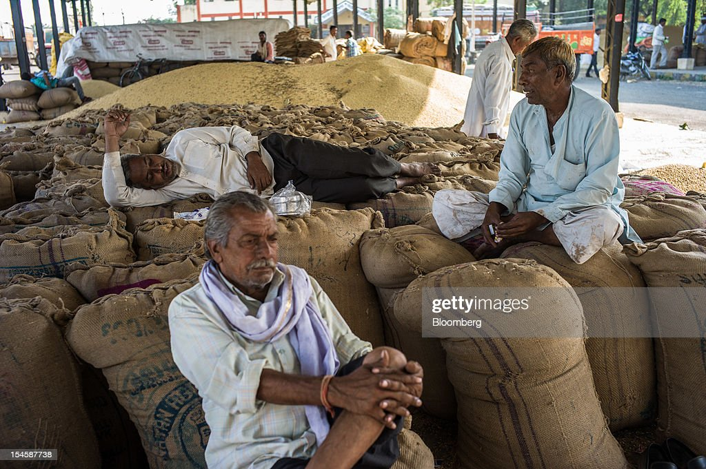 Farmers wait to sell their soybeans at a grain market in Burhanpur, Madhya Pradesh, India, on Friday, Oct. 19, 2012. Global soybean consumption will drop about 3 million metric tons in 2012-2013 as record prices curb demand for the oil made from the oilseed for food and biofuel, Thomas Mielke, executive director of Oil World, said. Photographer: Sanjit Das/Bloomberg via Getty Images