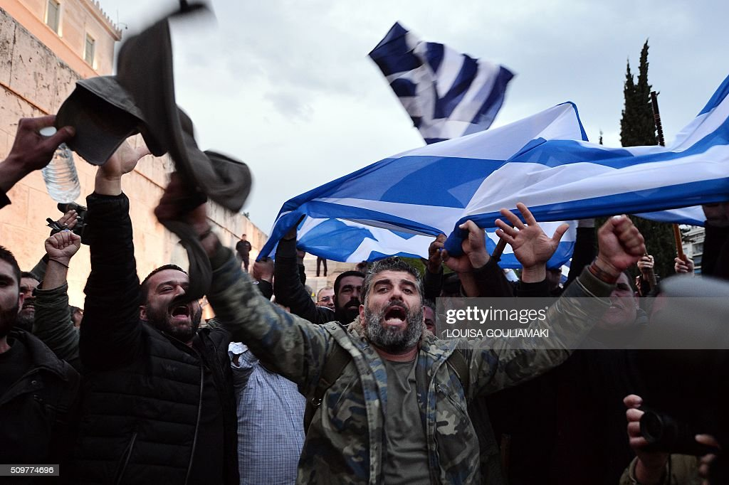 Farmers wave Greek flags and shout slogans in front of the Greek parliament in Athens during a rally against pension reform on February 12, 2016. Fears that Greece will exit the eurozone, a 'Grexit', could revive if Greek authorities do not come up with 'credible' reforms, notably on pensions, a senior IMF official said on February 11, 2016. / AFP / LOUISA GOULIAMAKI
