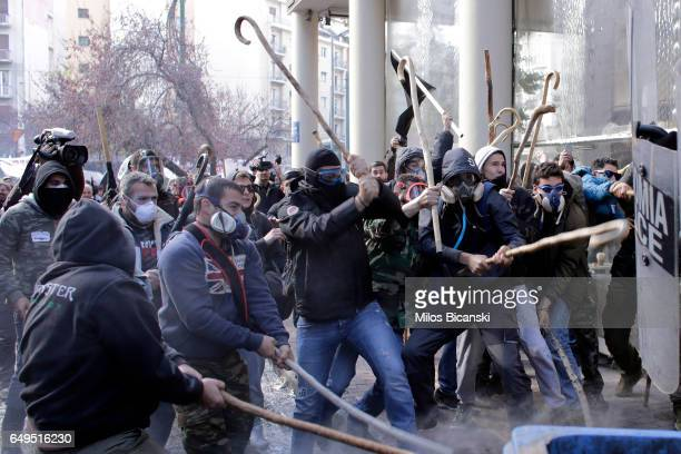 Farmers with shepherds crooks clash with riot policemen during a protest outside the Greek Agriculture Ministry on March 8 2017 in Athens Greece...