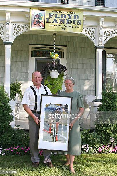 Paul and Arlene Landis parents of Tour de France winner Floyd Landis hold a painting of their son in front of their home in Farmersville Pennsylvania...