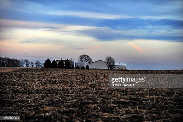 A farmhouse is picture at dusk in Ames Iowa on December 29 2011 Republican presidential hopeful Mitt Romney has seized the lead in Iowa days before...